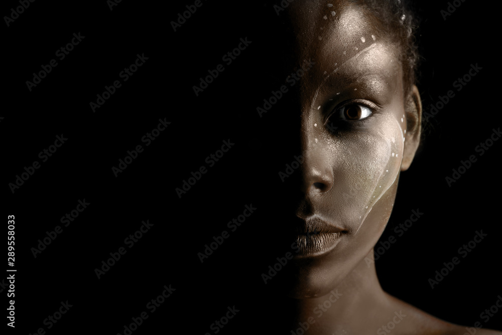 Fototapeta Art photo of Africal woman with tribal ethnic paintings on her face