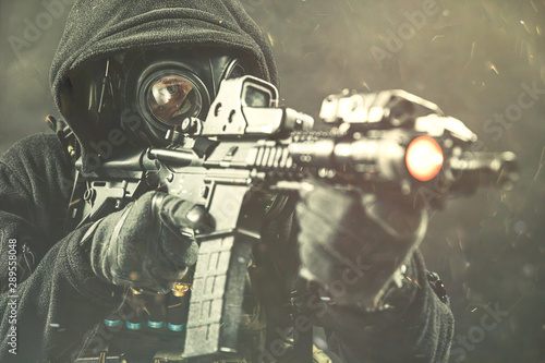 Elite special unit soldier is holding assault rifle and aiming at the target Canvas Print
