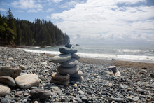 Stack Of Rocks On A Rocky Coast Along The Juan De Fuca Trail During A Sunny And Cloudy Summer Day. Taken At Sombrio Beach, Near Port Renfrew, Vancouver Island, BC, Canada.