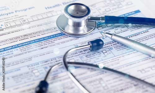 Fotografia  Stethoscope on Health Insurance Document / Medical Form