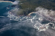 Aerial View from Above of a beautiful beach covered in Clouds and Fog at the West Pacific Ocean Coast. Taken near Tofino and Ucluelet in Vancouver Island, BC, Canada.