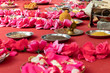 Leinwanddruck Bild - Indian wedding ceremony, decorations for traditional ethnic rituals for marriage, fire burning, flowers and statuettes of the deity on red carpet