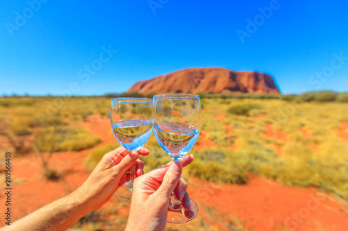 Foto auf Leinwand Honig Toast with two glasses, Central Australia, Northern Territory. Ayers Rock in Uluru-Kata Tjuta National Park on blurred background. Honeymoon in central Australia outback Blue sky copy space.