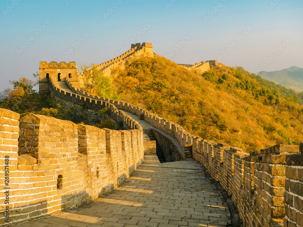 Fotografie, Obraz Stone stairwell leads up to the path on top of the majestic Great Wall of China