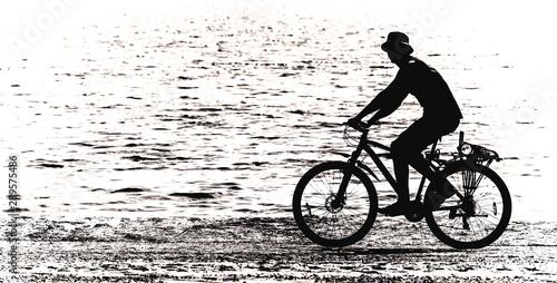 biker on the sandy beach