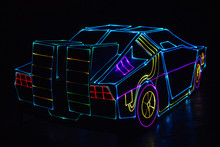 Classic American Cars In Colorful Neon Lights.