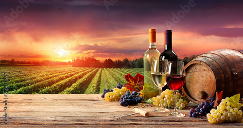 Acrylic Prints Wine Barrel Wineglasses And Bottle In Vineyard At Sunset