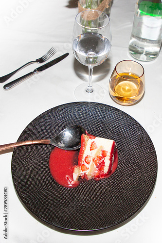 cake with raspberries and berry sauce on marty table in top view Wallpaper Mural