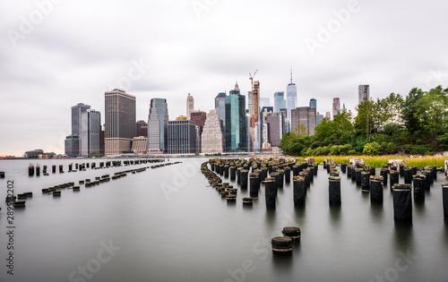 Manhattan panoramic skyline sunset view. New York City, USA. Office buildings and skyscrapers at Lower Manhattan (Downtown Manhattan)..