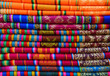Leinwanddruck Bild - A pile of colorful traditional textiles in the Andes mountain range sunday market of Otavalo, north of Quito, Ecuador.