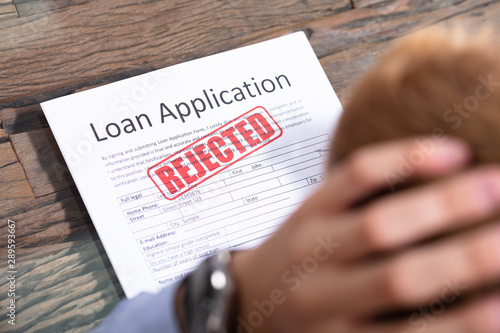 Fotografia  Person Looking At Rejected Loan Application