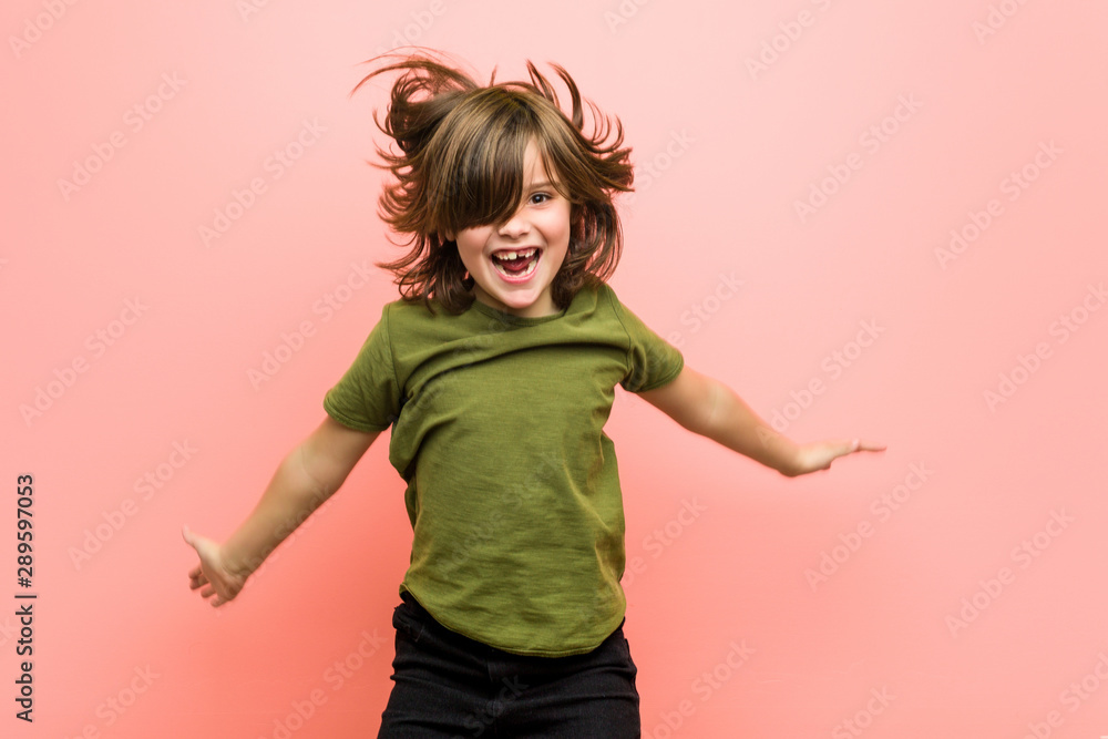 Fototapety, obrazy: Little caucasian boy playing against a pink background