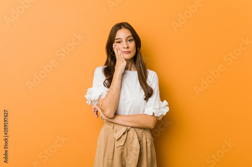 Young caucasian woman who is bored, fatigued and need a relax day Wallpaper Mural