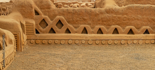 Panorama of the adobe walls and decorations in the archaeological site of Chan Chan made by the Chimu civilization near Trujillo, Peru Wallpaper Mural