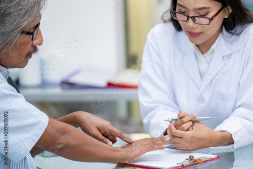 Valokuva  Blurred focus senior asian man patient meet woman pharmacist or doctor to advise