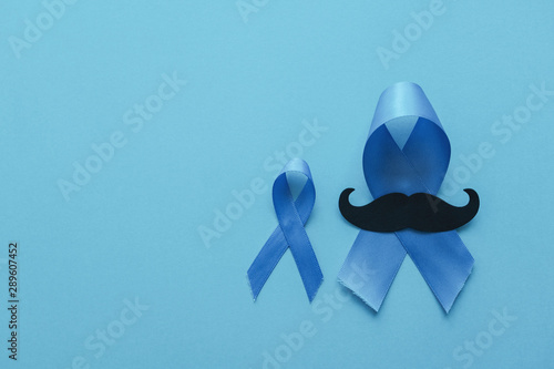 Photo Light blue ribbons with mustache on blue background , Prostate Cancer Awareness,