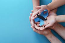 Family Hands Holding Light Blu...