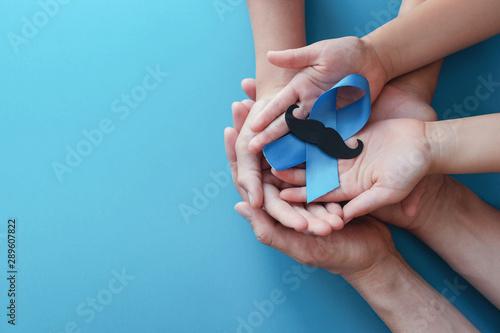 Family hands holding light blue ribbonwith mustache on blue background , Prostat Wallpaper Mural