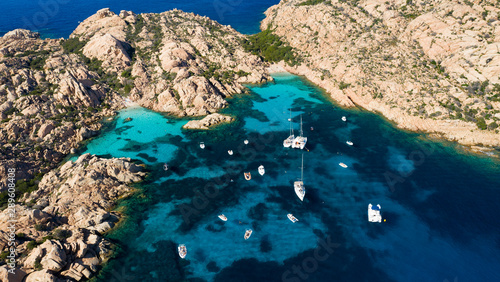Fotografie, Obraz  View from above, Stunning aerial view of Cala Coticcio also known as Tahiti with its rocky coasts and small beaches bathed by a turquoise clear water