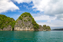 Limestone Cliff With Banca Boats On Lahus Island Beach In The Municipality Of Caramoan, Camarines Sur Province, Luzon In The Philippines, Region For Survivor TV Shows Filming.