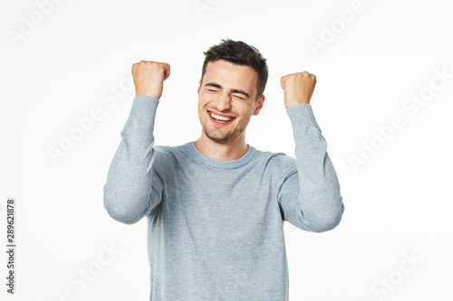 happy man with arms raised Canvas Print