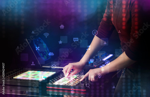 Hand mixing music on dj controller with social media concept icons - 289624437