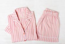 Pink Pajamas On White Wooden S...