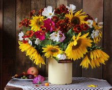 Still Life With Sunflowers And Other Garden Flowers, Berries And Fruits.