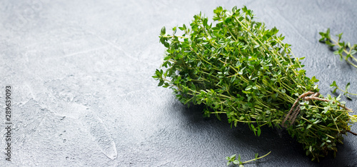 Valokuva Fresh thyme bunch on slate background. Close up. Copy space.