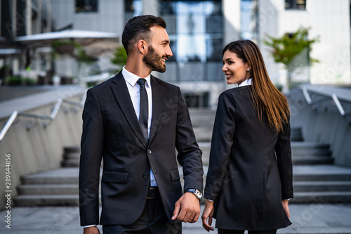 Fotografie, Tablou The happy woman and man walking in the business center