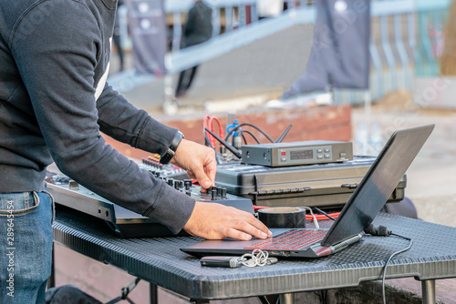 DJ plays music in the city street. Popular musical background. - 289645454