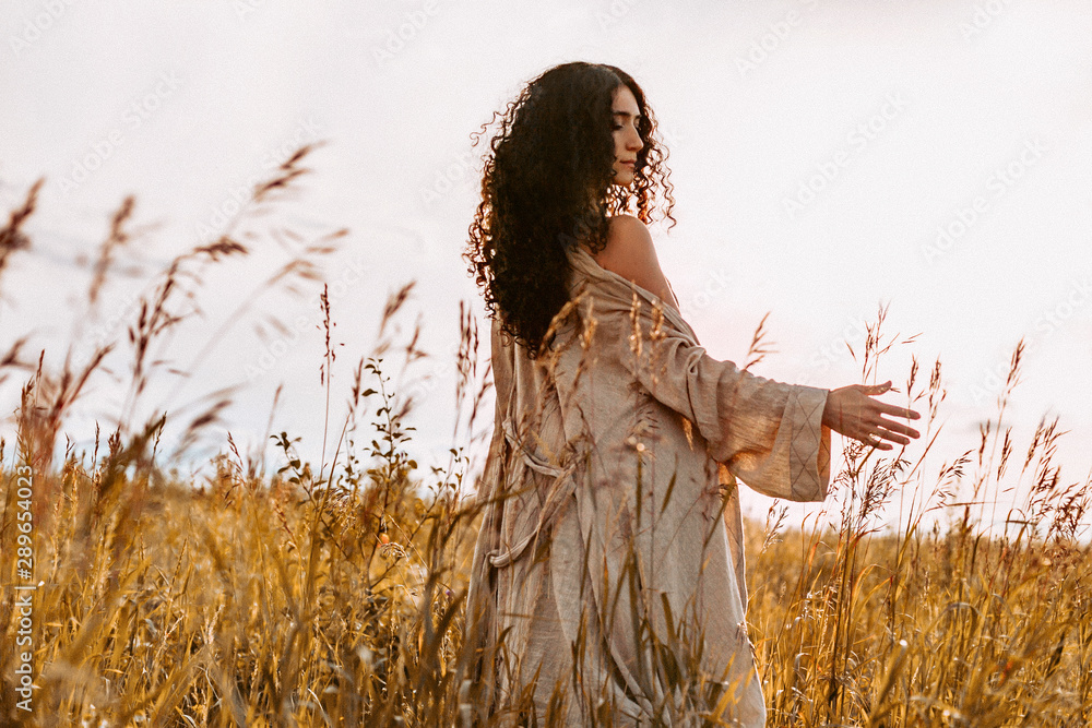 Fototapety, obrazy: beautiful young woman on a field at sunset