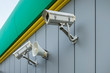 outdoor surveillance and tracking security camera with a megaphone on the wall of building
