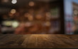 canvas print picture - Empty dark wooden table in front of abstract blurred bokeh background of restaurant . can be used for display or montage your products.Mock up for space.