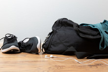 Sports Bag With Sports Equipment. Sportswear And Running Shoes