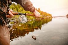Fisherman Using Rod Fly Fishing In Mountain River