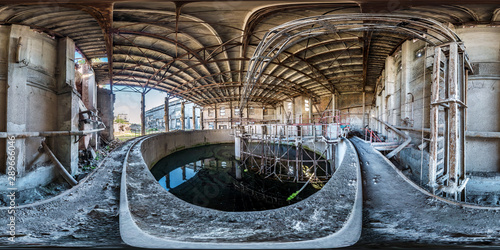 Full spherical seamless hdri panorama 360 degrees angle view concrete structures of abandoned ruined building of cement factory in equirectangular projection with zenith and nadir, VR AR content