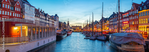 Panorama view of Copenhagen city skyline at night with view of Nyhavn in Copenha Wallpaper Mural
