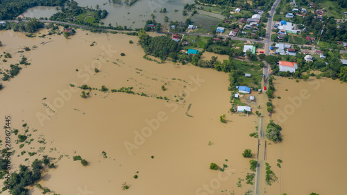 Fotografie, Obraz Aerial top view of Flooded rice paddies and the village, View from above shot by