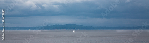 White Sail on a Grey Day in Puget Sound Wallpaper Mural