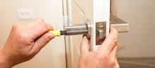 Man Is Installing The Doors Ha...