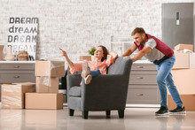 Young Couple Having Fun After Moving Into New House