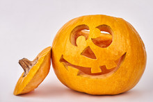 Funny Pumpkin For Halloween Holiday. Carved Halloween Pumpkin With Smiling Face On White Background. How To Carve Pumpkin For Halloween.