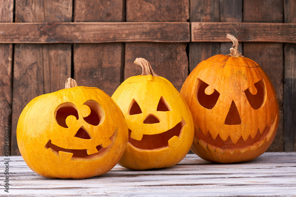 Fototapety, obrazy: Three carved pumpkins for Halloween. Funny and angry pumpkins for Halloween. Seasonal Halloween decorations.