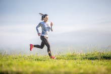 Young Sporty Woman Running In Nature. Morning Training Sportswoman