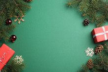 Frame Made Of Christmas Decorations On Green Background, Top View With Space For Text. Winter Season