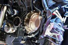 Selective Focused On A High Performance Motorcycle Engine. The Engine Is Installed On A Designed Motorcycle Chassis.