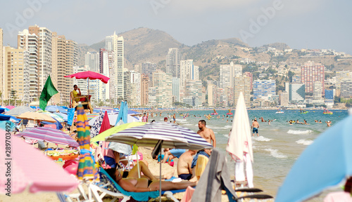 Lot of tourists on the beach of Benidorm, Costa Blanca, Spain