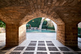 Fototapeta Kamienie - Inner yard with pool view through stony arch, Cathedral La Seu, Spain