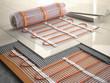 Leinwanddruck Bild - Underfloor heating installation concept. Mat elecric heating system with ceramic tiles and cement layers.